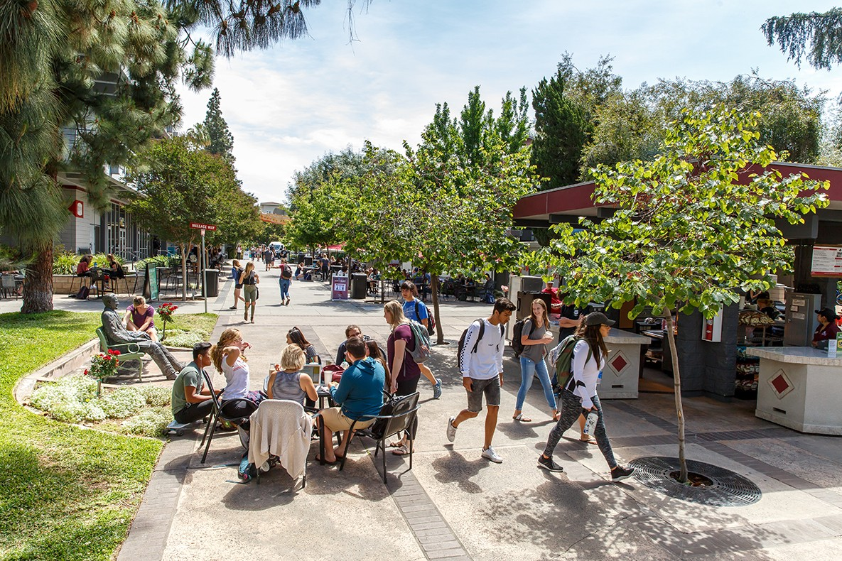 Students socialize and travel to and from class and other activities along Cougar Walk on APU's East Campus.